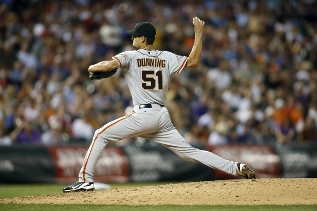 Jun 28, 2013; Denver, CO, USA; San Francisco Giants pitcher Jake Dunning (51) delivers a pitch during the sixth inning against the Colorado Rockies Coors Field. Mandatory Credit: Chris Humphreys-USA TODAY Sports