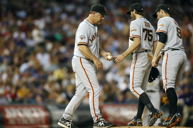 Jun 28, 2013; Denver, CO, USA; San Francisco Giants manager Bruce Bochy (left) relieves pitcher Barry Zito (75) during the sixth inning against the Colorado Rockies Coors Field. Mandatory Credit: Chris Humphreys-USA TODAY Sports