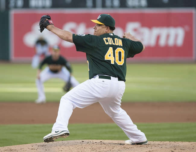 Jun 28, 2013; Oakland, CA, USA; Oakland Athletics starting pitcher Bartolo Colon (40) pitches against the St. Louis Cardinals during the first inning at O.Co Coliseum. Mandatory Credit: Ed Szczepanski-USA TODAY Sports