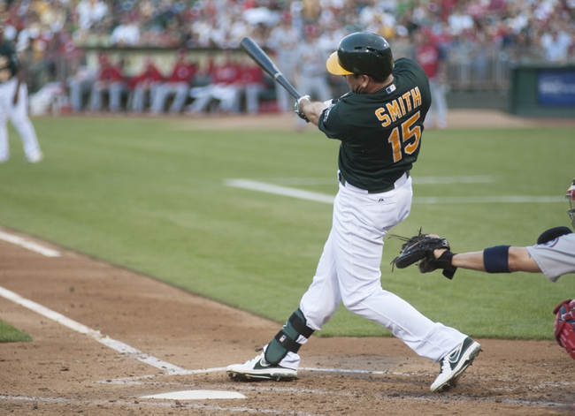 Jun 28, 2013; Oakland, CA, USA; Oakland Athletics left fielder Seth Smith (15) hits an RBI single during the second inning against the St. Louis Cardinals at O.Co Coliseum. Mandatory Credit: Ed Szczepanski-USA TODAY Sports