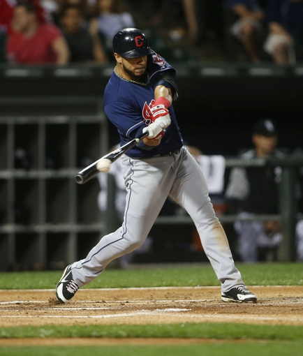 Jun 28, 2013; Chicago, IL, USA; Cleveland Indians shortstop Mike Aviles hits a single against the Chicago White Sox during the first inning in the second game of a baseball doubleheader at US Cellular Field. Mandatory Credit: Jerry Lai-USA TODAY Sports