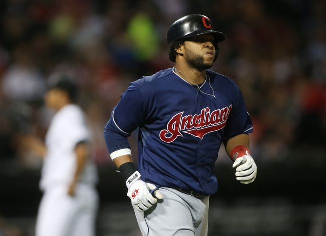 Jun 28, 2013; Chicago, IL, USA; Cleveland Indians catcher Carlos Santana draws a bases loaded walk against the Chicago White Sox during the first inning in the second game of a baseball doubleheader at US Cellular Field. Mandatory Credit: Jerry Lai-USA TODAY Sports