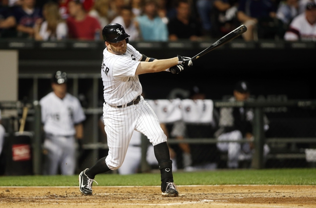 Jun 28, 2013; Chicago, IL, USA; Chicago White Sox first baseman Jeff Keppinger hits a single against the Cleveland Indians during the first inning in the second game of a baseball doubleheader at US Cellular Field. Mandatory Credit: Jerry Lai-USA TODAY Sports