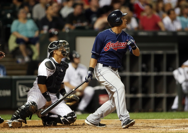 Jun 28, 2013; Chicago, IL, USA; Cleveland Indians left fielder Michael Brantley (23) drives in a run with a sacrifice fly against the Chicago White Sox during the first inning in the second game of a baseball doubleheader at US Cellular Field. Mandatory Credit: Jerry Lai-USA TODAY Sports