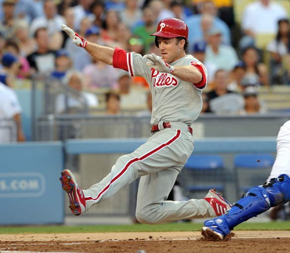 Jun 28, 2013; Los Angeles, CA, USA;  Philadelphia Phillies second baseman Chase Utley (26) scores a run in the second inning of the game against the Los Angeles Dodgers at Dodger Stadium. Mandatory Credit: Jayne Kamin-Oncea-USA TODAY Sports