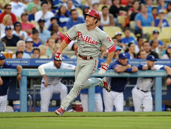 Jun 28, 2013; Los Angeles, CA, USA;  Philadelphia Phillies second baseman Chase Utley (26) rounds third base as he heads home to score a run in the second inning of the game against the Los Angeles Dodgers at Dodger Stadium. Mandatory Credit: Jayne Kamin-Oncea-USA TODAY Sports