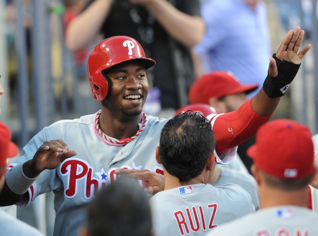 Jun 28, 2013; Los Angeles, CA, USA;  Philadelphia Phillies left fielder Domonic Brown (9) in the dugout after scoring a run in the second inning of the game against the Los Angeles Dodgers at Dodger Stadium. Mandatory Credit: Jayne Kamin-Oncea-USA TODAY Sports
