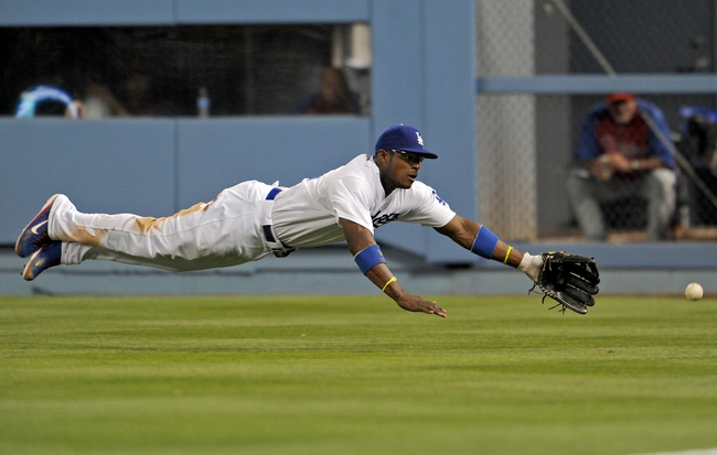 Jun 28, 2013; Los Angeles, CA, USA;  Philadelphia Phillies catcher Carlos Ruiz (not pictured) doubles off a diving Los Angeles Dodgers right fielder Yasiel Puig (66) in the fifth inning of the game at Dodger Stadium. Mandatory Credit: Jayne Kamin-Oncea-USA TODAY Sports