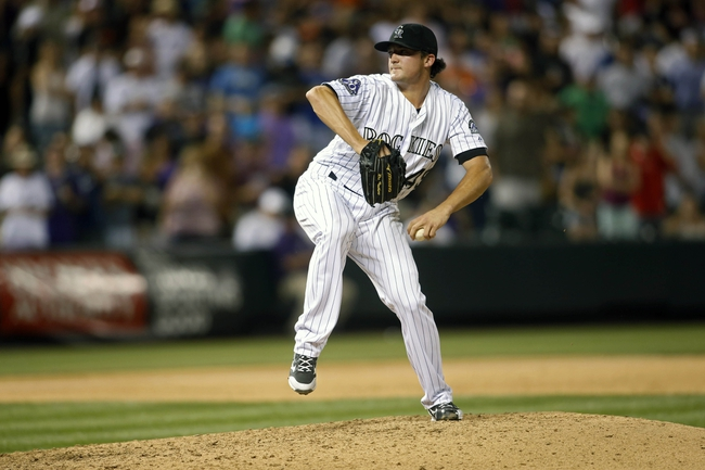 Jun 28, 2013; Denver, CO, USA; Colorado Rockies pitcher Rex Brothers (49) delivers a pitch during the ninth inning against the San Francisco Giants at Coors Field.  The Rockies won 4-1.  Mandatory Credit: Chris Humphreys-USA TODAY Sports