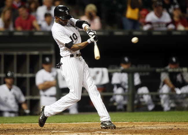 Jun 28, 2013; Chicago, IL, USA; Chicago White Sox shortstop Alexei Ramirez (10) hits a single against the Cleveland Indians during the fifth inning in the second game of a baseball doubleheader at US Cellular Field. Mandatory Credit: Jerry Lai-USA TODAY Sports