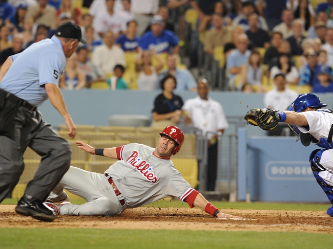 Jun 28, 2013; Los Angeles, CA, USA;  Philadelphia Phillies third baseman Michael Young (10) scores past Los Angeles Dodgers catcher Tim Federowicz (18) in the sixth inning of the game at Dodger Stadium. Mandatory Credit: Jayne Kamin-Oncea-USA TODAY Sports
