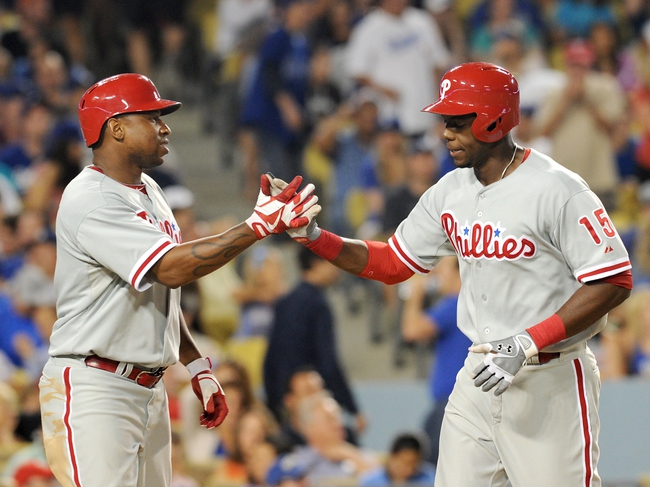 Jun 28, 2013; Los Angeles, CA, USA;  Philadelphia Phillies right fielder John Mayberry Jr. (15) is met by right fielder Delmon Young (3) after a 2-run home run in the sixth inning of the game against the Los Angeles Dodgers at Dodger Stadium. Mandatory Credit: Jayne Kamin-Oncea-USA TODAY Sports