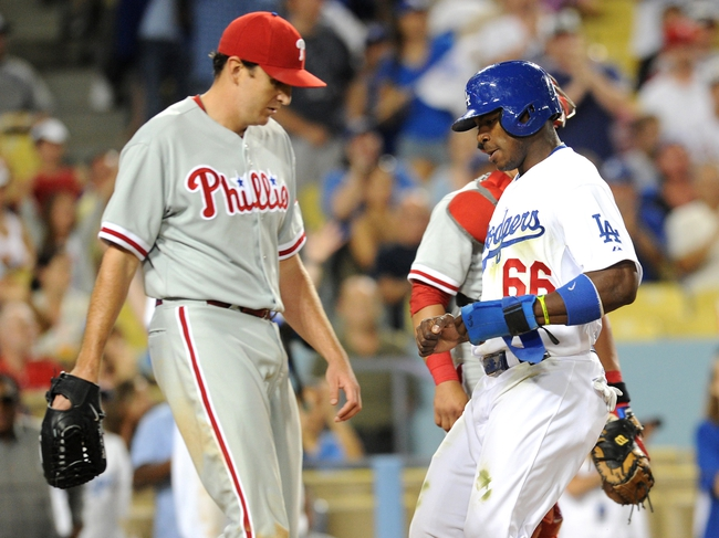 Jun 28, 2013; Los Angeles, CA, USA;  Philadelphia Phillies starting pitcher John Lannan (27) looks on as Los Angeles Dodgers right fielder Yasiel Puig (66) scores a run in the sixth inning of the game at Dodger Stadium. Mandatory Credit: Jayne Kamin-Oncea-USA TODAY Sports