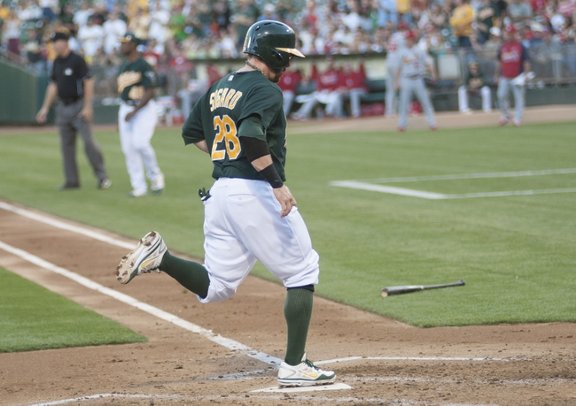 Jun 28, 2013; Oakland, CA, USA; Oakland Athletics second baseman Eric Sogard (28) scores during the second inning of the game against the St. Louis Cardinals at O.Co Coliseum. Mandatory Credit: Ed Szczepanski-USA TODAY Sports