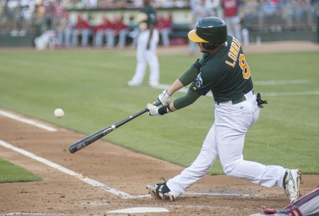 Jun 28, 2013; Oakland, CA, USA; Oakland Athletics shortstop Jed Lowrie (8) hits an rbi ground rule double during the second inning of the game against the St. Louis Cardinals at O.Co Coliseum. Mandatory Credit: Ed Szczepanski-USA TODAY Sports