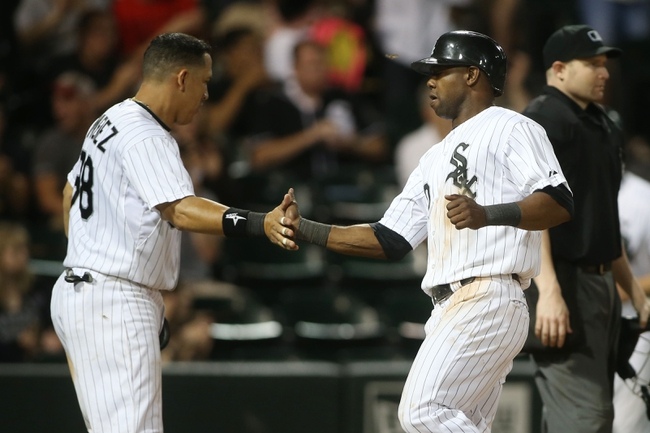 Jun 28, 2013; Chicago, IL, USA; Chicago White Sox shortstop Alexei Ramirez (10) celebrates with catcher Hector Gimenez (38) after scoring a run against the Cleveland Indians during the sixth inning in the second game of a baseball doubleheader at US Cellular Field. Mandatory Credit: Jerry Lai-USA TODAY Sports
