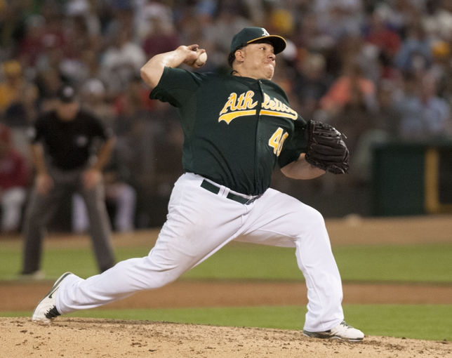 Jun 28, 2013; Oakland, CA, USA; Oakland Athletics starting pitcher Bartolo Colon (40) pitches against the St. Louis Cardinals during the fifth inning at O.Co Coliseum. Mandatory Credit: Ed Szczepanski-USA TODAY Sports