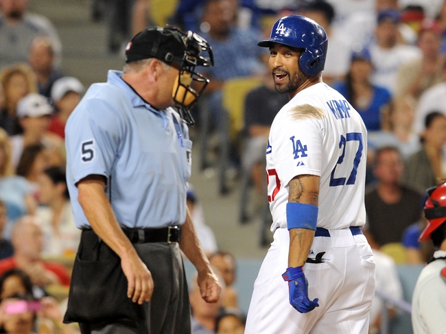 Jun 28, 2013; Los Angeles, CA, USA;  Los Angeles Dodgers center fielder Matt Kemp (27) argues with home plate umpire Dale Scott (5) after being called out on strikes in the eighth inning against the Philadelphia Phillies at Dodger Stadium. Phillies won 16-1. Mandatory Credit: Jayne Kamin-Oncea-USA TODAY Sports