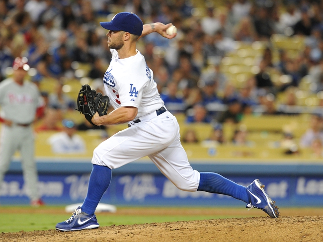 Jun 28, 2013; Los Angeles, CA, USA;  Los Angeles Dodgers relief pitcher Skip Schumaker (3) pitches in the ninth inning against the Philadelphia Phillies at Dodger Stadium. Phillies won 16-1. Mandatory Credit: Jayne Kamin-Oncea-USA TODAY Sports