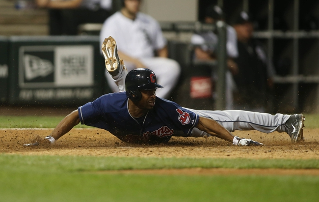 Jun 28, 2013; Chicago, IL, USA; Cleveland Indians center fielder Michael Bourn scores a run against the Chicago White Sox in the 9th inning of the second game of a baseball doubleheader at US Cellular Field. Mandatory Credit: Jerry Lai-USA TODAY Sports