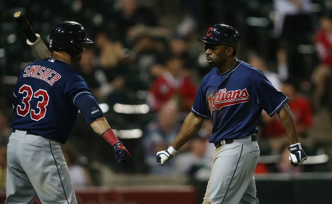 Jun 28, 2013; Chicago, IL, USA; Cleveland Indians center fielder Michael Bourn (right) celebrates with first baseman Nick Swisher (33) after scoring a run against the Chicago White Sox in the 9th inning of the second game of a baseball doubleheader at US Cellular Field. Mandatory Credit: Jerry Lai-USA TODAY Sports