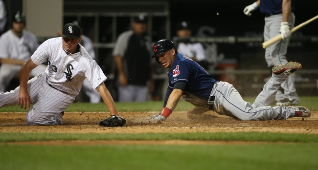 Jun 28, 2013; Chicago, IL, USA; Cleveland Indians shortstop Asdrubal Cabrera (right) scores a run on a wild pitch past Chicago White Sox relief pitcher Addison Reed (43) in the 9th inning of the second game of a baseball doubleheader at US Cellular Field. Mandatory Credit: Jerry Lai-USA TODAY Sports