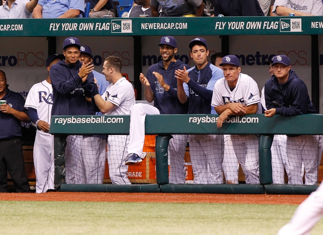 Jun 24, 2013; St. Petersburg, FL, USA; Tampa Bay Rays pitcher Chris Archer (22), pitcher David Price (14), pitcher Matt Moore (55) and teammates clap after right fielder Wil Myers (not pictured) hit a solo home run against the Toronto Blue Jays at Tropicana Field. Mandatory Credit: Kim Klement-USA TODAY Sports