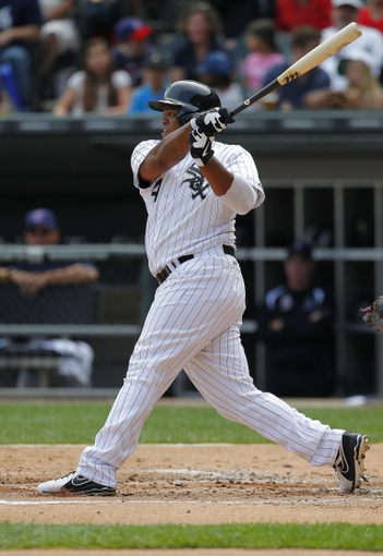 Jun 29, 2013; Chicago, IL, USA; Chicago White Sox left fielder Dayan Viciedo (24) hits a single during the second inning against the Cleveland Indians at US Cellular Field. Mandatory Credit: Dennis Wierzbicki-USA TODAY Sports