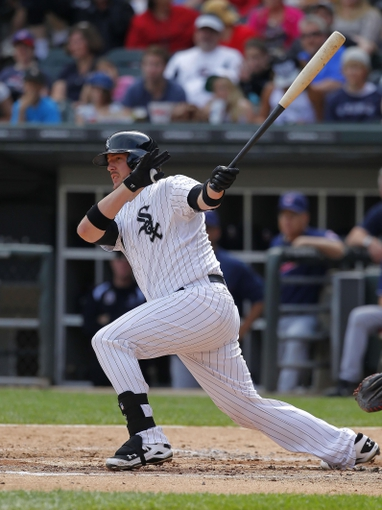 Jun 29, 2013; Chicago, IL, USA; Chicago White Sox catcher Tyler Flowers (21) hits an RBI double during the second inning against the Cleveland Indians at US Cellular Field. Mandatory Credit: Dennis Wierzbicki-USA TODAY Sports