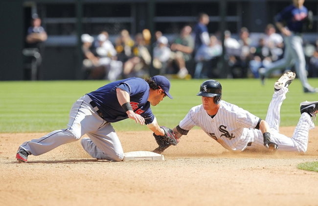 Jun 29, 2013; Chicago, IL, USA; Chicago White Sox second baseman Gordon Beckham (15) is tagged out trying to stretch a single into a double by Cleveland Indians second baseman Jason Kipnis (22) during the fourth inning at US Cellular Field. Mandatory Credit: Dennis Wierzbicki-USA TODAY Sports