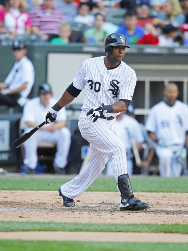 Jun 29, 2013; Chicago, IL, USA; Chicago White Sox center fielder Alejandro De Aza (30) hits a single during the sixth inning against the Cleveland Indians at US Cellular Field. Cleveland won 4-3. Mandatory Credit: Dennis Wierzbicki-USA TODAY Sports