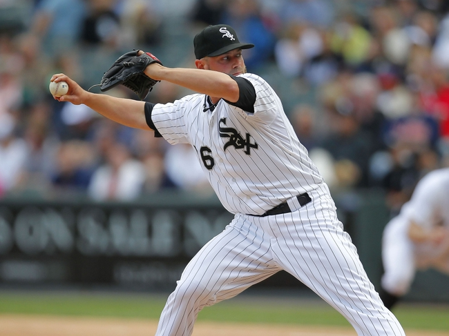 Jun 29, 2013; Chicago, IL, USA; Chicago White Sox relief pitcher Jesse Crain (26) delivers a pitch during the eighth inning against the Cleveland Indians at US Cellular Field. Cleveland won 4-3. Mandatory Credit: Dennis Wierzbicki-USA TODAY Sports