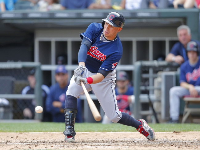 Jun 29, 2013; Chicago, IL, USA; Cleveland Indians shortstop Asdrubal Cabrera (13) hits a single during the eighth inning against the Chicago White Sox at US Cellular Field. Cleveland won 4-3. Mandatory Credit: Dennis Wierzbicki-USA TODAY Sports