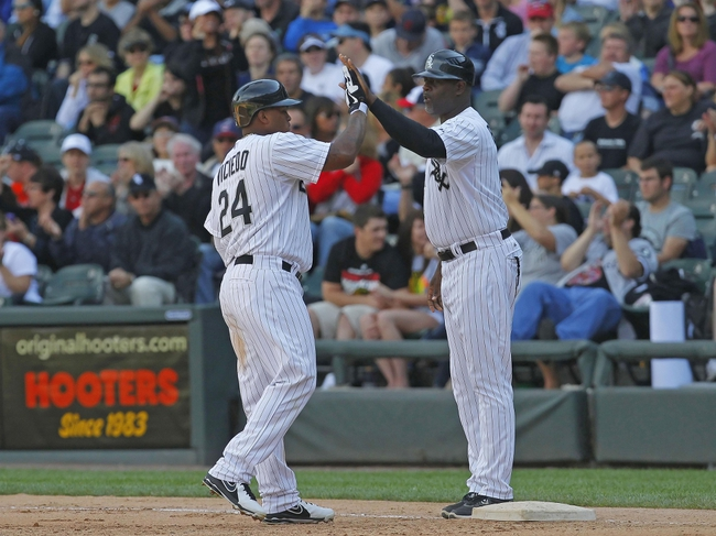 Jun 29, 2013; Chicago, IL, USA; Chicago White Sox left fielder Dayan Viciedo (24) is congratulated by first base coach Daryl Boston (17) for hitting an RBI single during the fifth inning at US Cellular Field. Cleveland won 4-3. Mandatory Credit: Dennis Wierzbicki-USA TODAY Sports