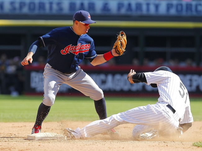 Jun 29, 2013; Chicago, IL, USA; Chicago White Sox right fielder Alex Rios (51) steals second base under the tag of Cleveland Indians shortstop Asdrubal Cabrera (13) during the fifth inning at US Cellular Field. Cleveland won 4-3. Mandatory Credit: Dennis Wierzbicki-USA TODAY Sports