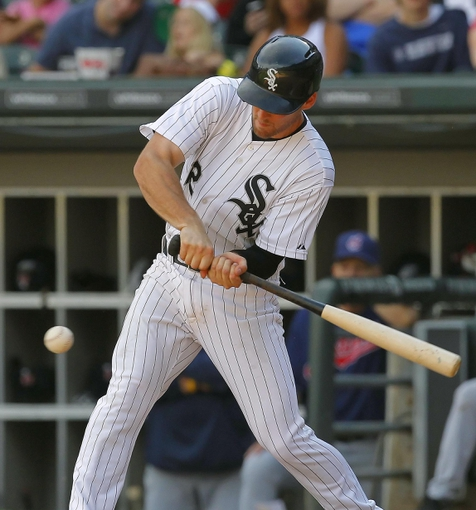 Jun 29, 2013; Chicago, IL, USA; Chicago White Sox third baseman Conor Gillaspie (12) hits an RBI single during the fifth inning against the Cleveland Indians at US Cellular Field. Cleveland won 4-3. Mandatory Credit: Dennis Wierzbicki-USA TODAY Sports