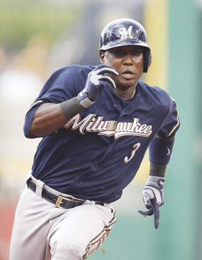 Jun 30, 2013; Pittsburgh, PA, USA; Milwaukee Brewers third baseman Yuniesky Betancourt (3) goes from first to third base against the Pittsburgh Pirates during the second inning at PNC Park. Mandatory Credit: Charles LeClaire-USA TODAY Sports