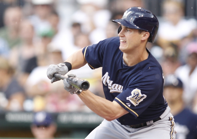 Jun 30, 2013; Pittsburgh, PA, USA; Milwaukee Brewers left fielder Logan Schafer (22) hits an RBI sacrifice bunt against the Pittsburgh Pirates during the second inning at PNC Park. Mandatory Credit: Charles LeClaire-USA TODAY Sports