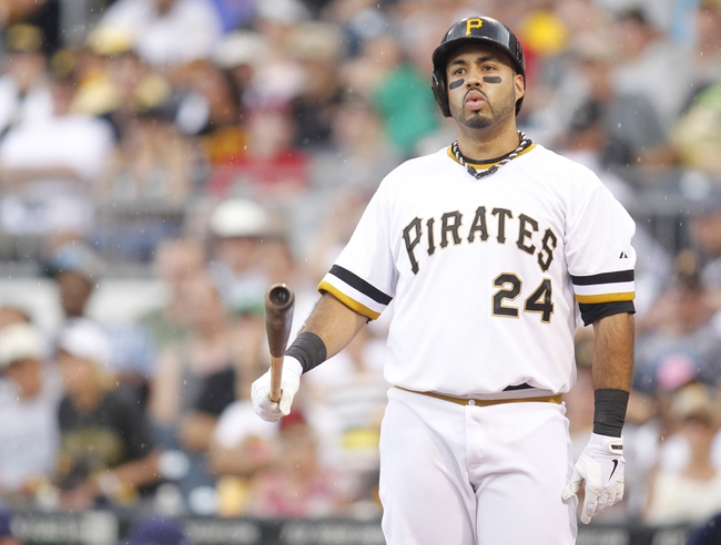 Jun 30, 2013; Pittsburgh, PA, USA; Pittsburgh Pirates third baseman Pedro Alvarez (24) reacts after a striking out against the Milwaukee Brewers during the second inning at PNC Park. Mandatory Credit: Charles LeClaire-USA TODAY Sports