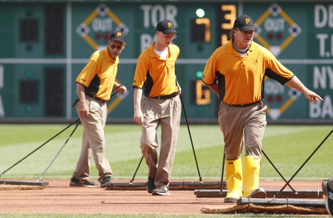 Jun 30, 2013; Pittsburgh, PA, USA; Pittsburgh Pirates ground crew members prepare the field for a resumption of play between the Milwaukee Brewers and the Pittsburgh Pirates after a rain delay during the second inning at PNC Park. Mandatory Credit: Charles LeClaire-USA TODAY Sports