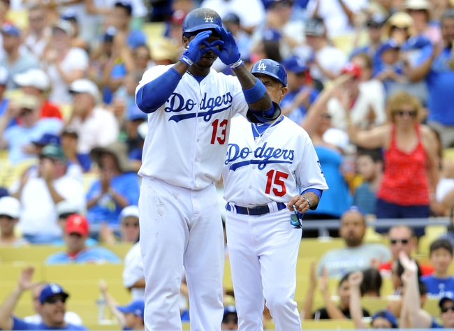June 30, 2013; Los Angeles, CA, USA; Los Angeles Dodgers shortstop Hanley Ramirez (13) reacts after he hits an RBI single in the third inning against the Philadelphia Phillies at Dodger Stadium. Mandatory Credit: Gary A. Vasquez-USA TODAY Sports