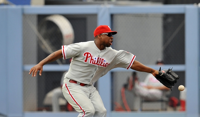June 30, 2013; Los Angeles, CA, USA; Philadelphia Phillies right fielder Delmon Young (3) misses catching a fly ball in the fifth inning against the Los Angeles Dodgers at Dodger Stadium. Mandatory Credit: Gary A. Vasquez-USA TODAY Sports