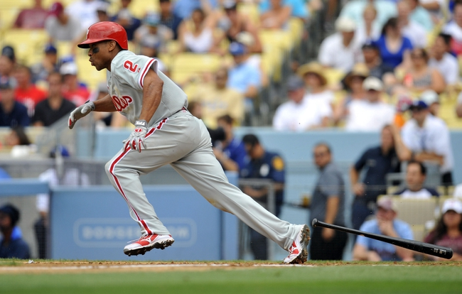June 30, 2013; Los Angeles, CA, USA; Philadelphia Phillies center fielder Ben Revere (2) hits a single during the fifth inning against the Los Angeles Dodgers at Dodger Stadium. Mandatory Credit: Gary A. Vasquez-USA TODAY Sports
