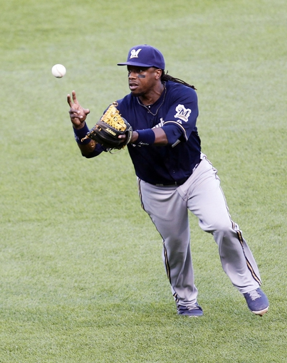 Jun 30, 2013; Pittsburgh, PA, USA; Milwaukee Brewers second baseman Rickie Weeks (23) misplays a ground ball hit by Pittsburgh Pirates first baseman Gaby Sanchez (not pictured) during the fourteenth inning at PNC Park. The Pittsburgh Pirates won 2-1 in fourteen innings. Mandatory Credit: Charles LeClaire-USA TODAY Sports