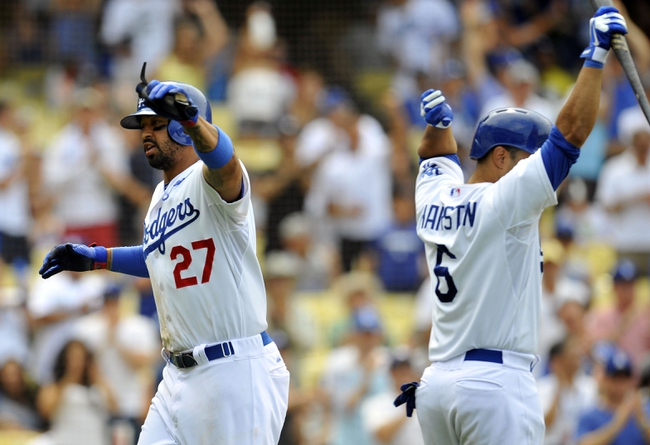 June 30, 2013; Los Angeles, CA, USA; Los Angeles Dodgers center fielder Matt Kemp (27) celebrates with third baseman Jerry Hairston Jr. (6) after scoring a run in the eighth inning against the Philadelphia Phillies at Dodger Stadium. Mandatory Credit: Gary A. Vasquez-USA TODAY Sports