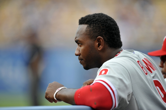 June 30, 2013; Los Angeles, CA, USA; Philadelphia Phillies left fielder Domonic Brown (9) watches game action during the ninth inning against the Los Angeles Dodgers at Dodger Stadium. Mandatory Credit: Gary A. Vasquez-USA TODAY Sports