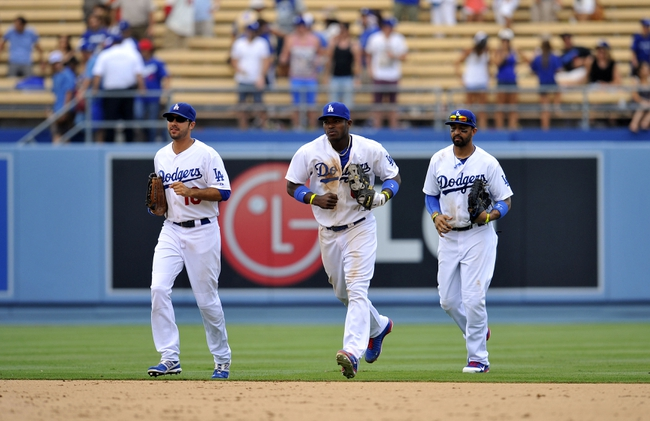 June 30, 2013; Los Angeles, CA, USA; Los Angeles Dodgers right fielder Andre Ethier (16), right fielder Yasiel Puig (66) and center fielder Matt Kemp (27) following the 6-1 victory against the Philadelphia Phillies at Dodger Stadium. Mandatory Credit: Gary A. Vasquez-USA TODAY Sports