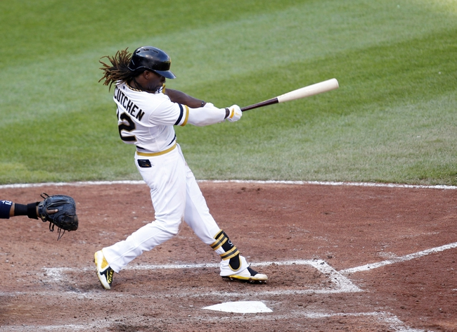 Jun 30, 2013; Pittsburgh, PA, USA; Pittsburgh Pirates center fielder Andrew McCutchen (22) hits an RBI single against the Milwaukee Brewers during the eighth inning at PNC Park. The Pittsburgh Pirates won 2-1 in fourteen innings. Mandatory Credit: Charles LeClaire-USA TODAY Sports