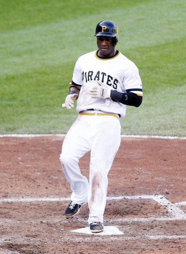 Jun 30, 2013; Pittsburgh, PA, USA; Pittsburgh Pirates left fielder Starling Marte (6) crosses home plate to score a run against the Milwaukee Brewers during the eighth inning at PNC Park. The Pittsburgh Pirates won 2-1 in fourteen innings. Mandatory Credit: Charles LeClaire-USA TODAY Sports