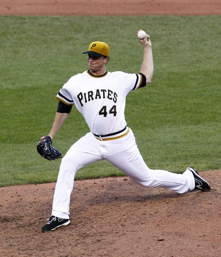 Jun 30, 2013; Pittsburgh, PA, USA; Pittsburgh Pirates relief pitcher Tony Watson (44) delivers a pitch against the Milwaukee Brewers during the fourteenth inning at PNC Park. The Pittsburgh Pirates won 2-1 in fourteen innings. Mandatory Credit: Charles LeClaire-USA TODAY Sports